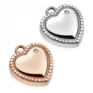Pendentif coeur serti en acier à contours en pointillets