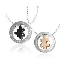 Paire de pendentifs acier � puzzle encercl�